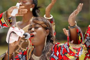 A Christian faithful from the World Victory Centre sings hymns during an Easter crusade service for the victims of the Garissa University attack in Kenya's capital Nairobi April 5, 2015. REUTERS/Thomas Mukoya