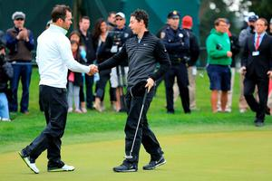 Rory McIlroy of Northern Ireland shakes hands with Paul Casey of England after winning their quarter final match the World Golf Championships Cadillac Match Play in 22 holes Sunday morning after it was suspended due to darkness the previous day at TPC Harding Park