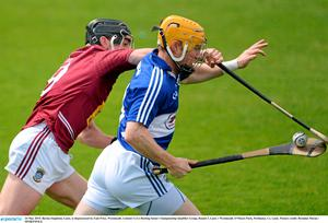 24 May 2015; Barina Stapleton, Laois, is dispossessed by Eoin Price, Westmeath. Leinster GAA Hurling Senior Championship Qualifier Group, Round 3, Laois v Westmeath. O'Moore Park, Portlaoise, Co. Laois. Picture credit: Brendan Moran / SPORTSFILE
