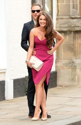 Brooke Vincent and Anthony Cotton, make their way to St Mary's Church in Bury St Edmunds, Suffolk, for the wedding of former Coronation Street actress Michelle Keegan to The Only Way Is Essex star Mark Wright. PRESS ASSOCIATION Photo. Picture date: Sunday May 24, 2015. See PA story SHOWBIZ Keegan. Photo credit should read: Yui Mok/PA Wire