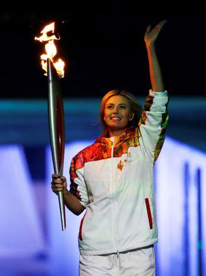 Russian tennis player Maria Sharapova carries the Olympic torch during the opening ceremony of the 2014 Winter Olympics in Sochi