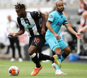 Newcastle's Allan Saint-Maximin in action with Tottenham's Lucas Moura. Photo: Reuters