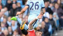 Manchester United's Marcos Rojo battles for the ball with Manchester City's Martin Demichelis (left) before going off the pitch with an injury