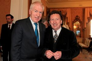 16/4/13 Minister Jimmy Deenihan with Frankie Gavin, De Dannan, at the book launch/birthday party for Brendan Kennelly in the Shelbourne Hotel, Dublin. Picture:Arthur Carron/Collins