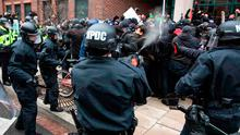 Police officers pepper-spray a group of protesters in Washington, DC, yesterday. Photo: Zach Gibson/Getty