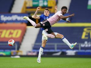 Leicester City's Demarai Gray in action with Everton's Lucas Digne. Photo: Jon Super/Pool via Reuters