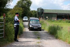 Hearses transport two sets of human remains which were found in a reclaimed bog in Coghalstown, Co Meath, after the families of two of the IRA Disappeared visited a site in the Irish Republic where it is believed the remains of their loved ones have been found. PRESS ASSOCIATION Photo. Picture date: Friday June 26, 2015. The bodies - which will undergo DNA tests over the next few weeks - are thought to be that of Seamus Wright and Kevin McKee, both abducted and murdered by the terror group in Belfast in October 1972. See PA story IRISH Lynskey. Photo credit should read: Niall Carson/PA Wire