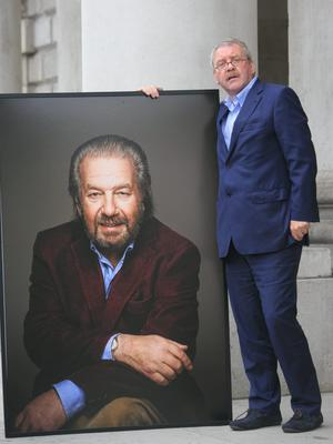 11/06/2015 Michael Colgan with a large photo of Paolo Tullio during the Humanist Funeral Service for Paolo Tullio at The Exam Hall in Trinity College, Dublin. Photo: Gareth Chaney Collins