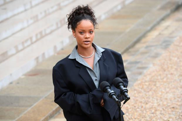 Barbadian musician and Global Ambassador for the Global Partnership for Education Rihanna speaks to the press as she leaves the Elysee Palace in Paris after a meeting with the French president on July 26, 2017. / AFP PHOTO / CHRISTOPHE ARCHAMBAULTCHRISTOPHE ARCHAMBAULT/AFP/Getty Images