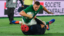 Andrew Conway goes over to score Ireland's fourth try despite the efforts of Scotland's Grant Gilchrist. Photo by Brendan Moran/Sportsfile
