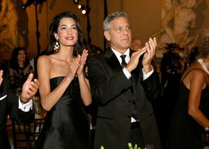 George Clooney (R) and fiance Amal Alamuddin