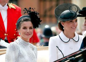 Spain's Queen Letizia (L) and Britain's Catherine, Duchess of Cambridg leave from St George's Chapel after attending the Most Noble Order of the Garter Ceremony in Windsor Castle in Windsor, west of London on June 17, 2019