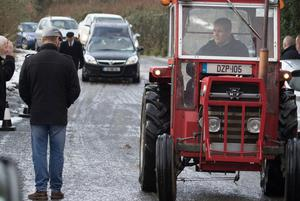 A vintage Massey Ferguson 135 leads the funeral cortege of tragic Willie Wilson to Ray Church, Manorcunningham. (North West Newspix)