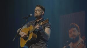 Bradley Grace performing at the Olympia on his father Brendan Grace's old guitar