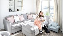 Sarah Power in her living room with Lucy and baby Zach. The sofas are from Harvey Norman. The mirror is from KA International in Blackrock. Photo: Tony Gavin