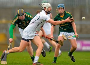 Paul Divilly, Kildare, in action against Michael Dunne, left, and Stephen Morris, Meath