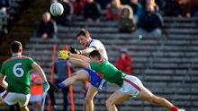 Shooting star: Conor McManus of Monaghan gets his shot away despite the efforts of Mayo pair Oisín Mullin (right) and Michael Plunkett. Photo: Ben McShane/Sportsfile