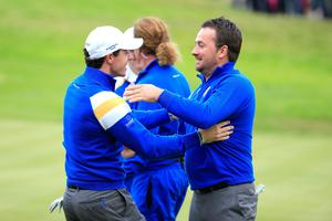 AUCHTERARDER, SCOTLAND - SEPTEMBER 28: Graeme McDowell (R) of Europe celebrates victory against Jordan Spieth of the United States with team mate Rory McIlroy on the 17th hole during the Singles Matches of the 2014 Ryder Cup on the PGA Centenary course at the Gleneagles Hotel on September 28, 2014 in Auchterarder, Scotland.  (Photo by Harry How/Getty Images)
