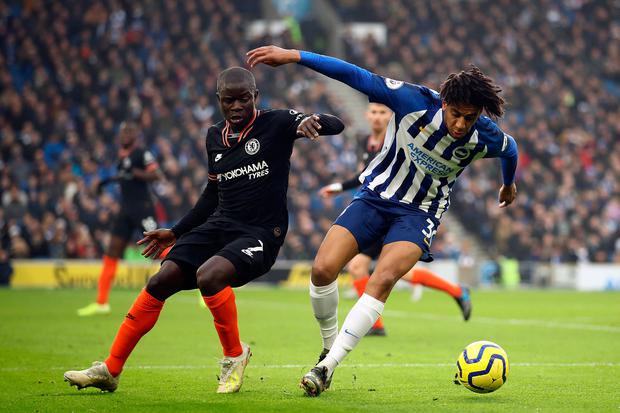 N'Golo Kante of Chelsea challenges Bernardo of Brighton & Hove Albion. Photo by Bryn Lennon/Getty Images