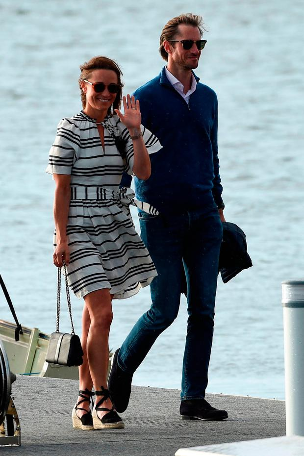 Pippa Middleton (L) and her husband James Matthews (R) arrive at Rose Bay Wharf by sea plane in Sydney on May 31, 2017