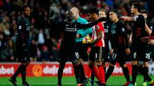 Liverpool's Sadio Mane looks dejected after conceding the second penalty at the Stadium of Light yesterday