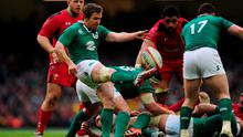 Eoin Reddan of Ireland puts in a box kick during the RBS Six Nations match between Wales and Ireland at Millennium Stadium