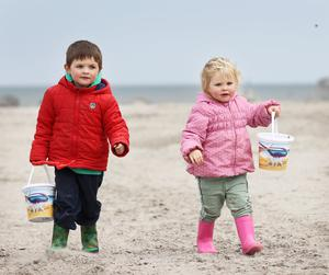 Enjoying the dry weather: Clodagh Kelly (2) from Santry with her brother Sean (3) on Dollymount Strand, Dublin. Photo: Frank McGrath