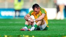 Donegal's Karl Lacey sits dejected on the Croke Park turf after his side's All-Ireland final defeat to Kerry. Photo: Ramsey Cardy / SPORTSFILE