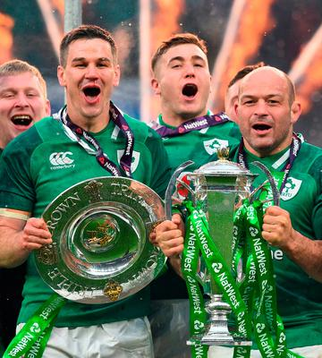 Jonathan Sexton (left)  holds the Triple Crown and Ireland's hooker Rory Best (R) holds the Six Nations trophy