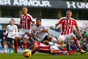Tottenham Hotspur's Nacer Chadli is challenged by Stoke City's (L-R) Steve Sidwell, Phil Bardsley and Ryan Shawcross. Photo credit: REUTERS/Eddie Keogh