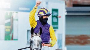 Cover story: Finian Maguire celebrates aboard Princess Zoe after winning yesterday's Connacht Hotel Handicap. Photo: Niall Carson/PA Wire