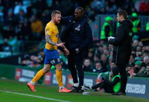 Kilmarnock's Alan Power walks off after being sent off at Celtic Park. Photo: Andrew Milligan/PA Wire