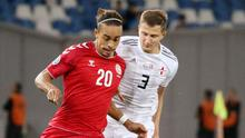 Denmark's Yussuf Poulsen in action with Georgia's Jemal Tabidze. Photo: Reuters/Vasil Gedenidze