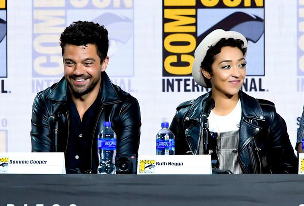 """(L-R) Dominic Cooper and Ruth Negga speak at the """"Preacher"""" Panel during 2019 Comic-Con International at San Diego Convention Center on July 19, 2019 in San Diego, California. (Photo by Kevin Winter/Getty Images)"""