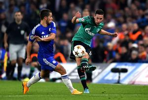 Schalke's Julian Draxler gets a cross in as Eden Hazard of Chelsea closes in during the Champions League game at Stamford Bridge. Photo: Mike Hewitt/Getty Images