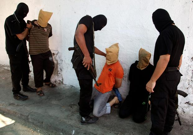 Hamas militants grab Palestinians suspected of collaborating with Israel, before executing them in Gaza City