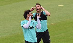 James Milner and Mo Salah share a joke during training yesterday ahead of tomorrow's game against Everton. Photo by John Powell/Liverpool FC via Getty Images