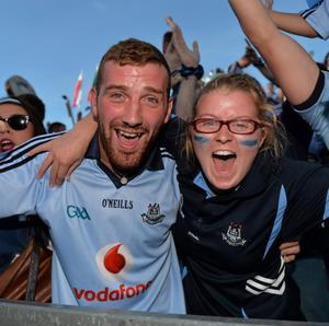 22 September 2013; Dublin supporters Anthony Brennan and Amy Brennan, from Portmarnock, celebrate their sides victory during the GAA Football All-Ireland Championship Finals, Croke Park, Dublin. Picture credit: Barry Cregg / SPORTSFILE