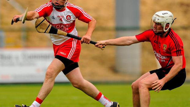 Derry's Sean McCullagh in action against Down's Declan McManus during yesterday's Ulster SHC semi-final in Owenbeg, Derry SEB DALY / SPORTSFILE