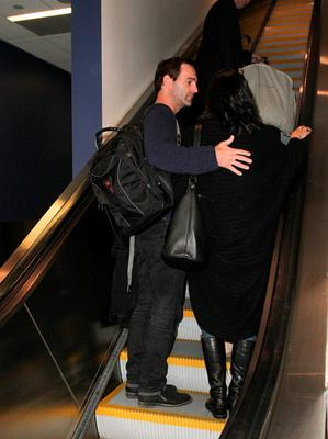 Johnny McDaid and Courteney Cox are seen at LAX
