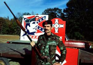 Alleged Kansas gunman Frazier Glenn Miller poses with a shotgun and a pistol tucked into his military-style web belt before a Carolina Knights of the Ku Klux Klan rally in Robeson County, N.C., in November 1984. Photo by Scott Sharpe/Raleigh News & Observer/MCT/ABACAPRESS.COM
