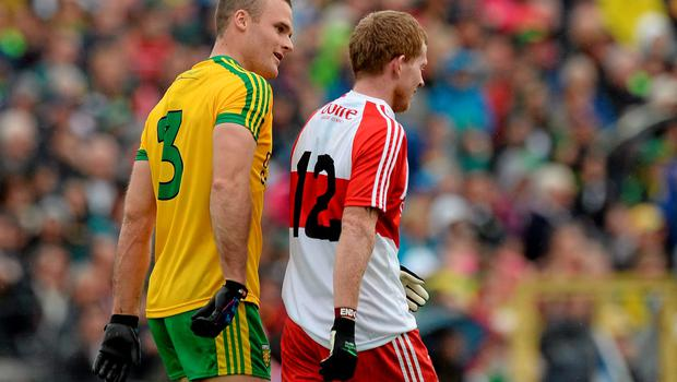 27 June 2015; Neil Gallagher, Donegal, talks to Enda Lynn, Derry, off the ball. Ulster GAA Football Senior Championship, Semi-Final, Derry v Donegal. St Tiernach's Park, Clones, Co. Monaghan. Picture credit: Oliver McVeigh / SPORTSFILE