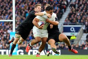 England's Billy Vunipola is tackled by Richie McCaw of New Zealand during their clash at Twickenham. Photo: Gareth Fuller/PA Wire