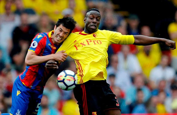 Watford's Stefano Okaka in action with Crystal Palace's James Tomkins. Photo: Darren Staples/Reuters