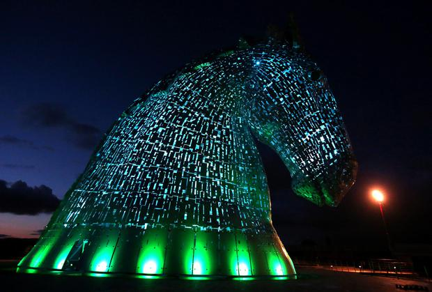 A lighting test is carried out on the Kelpies in Falkirk ahead of their  official opening to the public later this month. PRESS ASSOCIATION Photo. Picture date: Monday April 7, 2014. Designed by sculptor Andy Scott each of The Kelpies stands up to 30 metres tall and each one weighs over 300 tonnes. They are constructed of structural steel with a stainless steel outer skin, they pay homage to the tradition of working horses of Scotland which used to pull barges along Scotland's canals.  They stand at the entrance to the North Sea at the Forth and Clyde canal. Photo credit should read: Andrew Milligan/PA Wire
