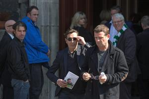 Aslan's lead singer Christy Dignam and band member Billy McGuinness at the funeral mass of journalist John 'George' Byrne at Saint Nicholas of Myra Church in Francis Street, Dublin. Photo: Mark Condren