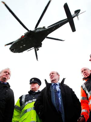 Minister Shane Ross visits Blacksod Pier alongside, from left, Cllr Gerry Coyle, Garda Supt Tony Healy from Belmullet, Gerard O'Flynn, Operations Manager Irish Coast Guard, and Kevin Boxer Moran TD. Photo: Steve Humphreys