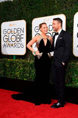 Actress Blake Lively and husband Ryan Reynolds arrive at the 74th annual Golden Globe Awards