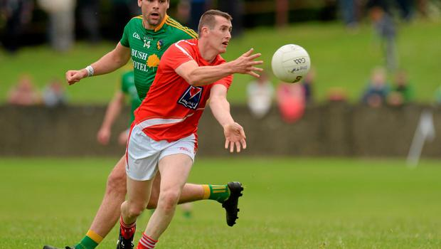 27 June 2015; Dessie Finnegan, Louth, in action against Donal Wrynn, Leitrim. GAA Football All-Ireland Senior Championship, Round 1B, Louth v Leitrim. County Grounds, Drogheda, Co. Louth. Picture credit: Piaras Ó Mídheach / SPORTSFILE