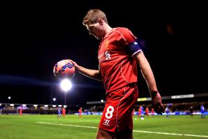 Steven Gerrard of Liverpool prepares to take a corner during the FA Cup Third Round match between AFC Wimbledon and Liverpool at The Cherry Red Records Stadium